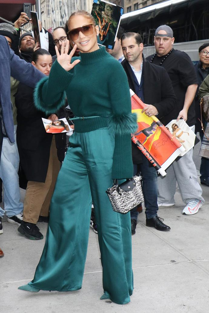 Carrying her Longchamp Mini Le Pliage Tote in New York on November 11, 2019.