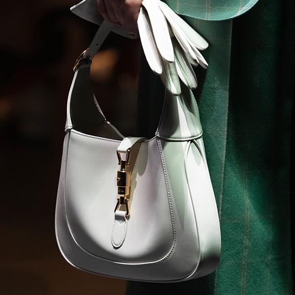 """**Eugenie Kelly, Editor-In-Chief** <br><br/> """"The perfect size to fit all the essentials, this Gucci bag is my pick of the season. The crisp white feels luxurious with the golden clasp, and the short strap makes it a chic top-handle, or an old-school over-the-shoulder."""""""