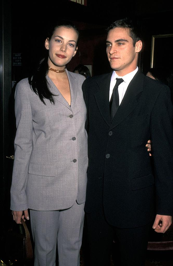"""**Liv Tyler and Joaquin Phoenix** <br><br> Definitely one of the coolest couples of the '90s, Tyler and Phoenix dated between 1995 and 1998, when they were both young stars. <br><br> In a 2015 interview with [*ELLE* U.S.](https://www.elle.com/culture/movies-tv/interviews/a31492/liv-tyler-the-leftovers/
