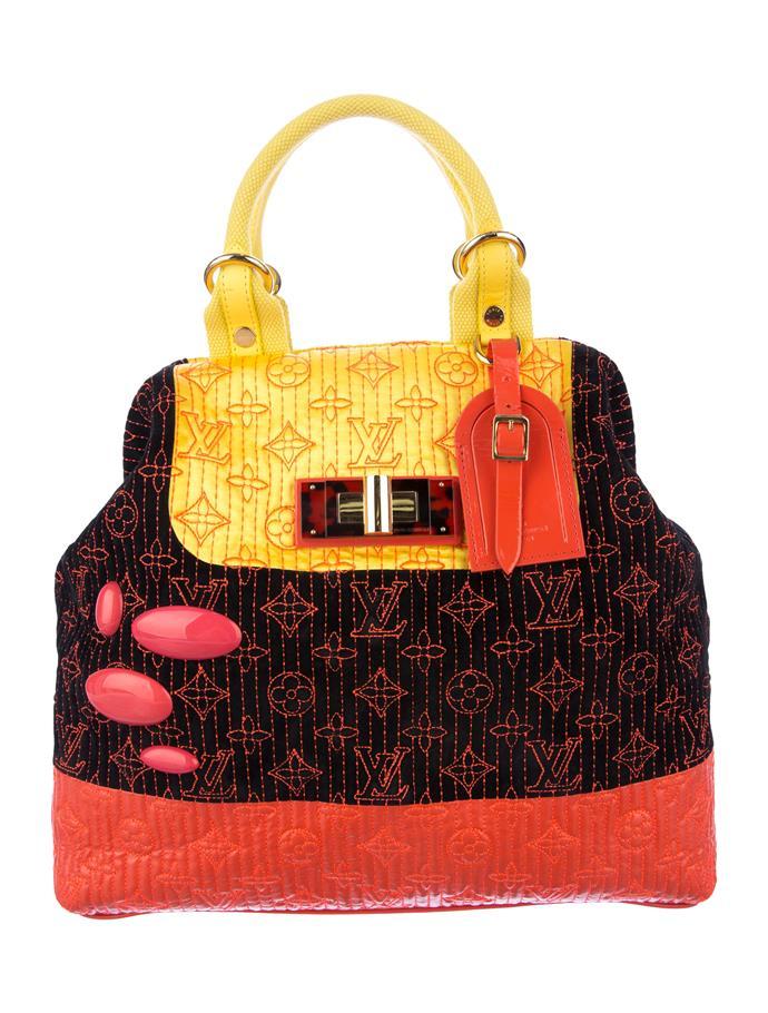"Image via [The Real Real](https://www.therealreal.com/products/women/handbags/handle-bags/louis-vuitton-neon-noir-monogram-motard-firebird-bag|target=""_blank""|rel=""nofollow"")."
