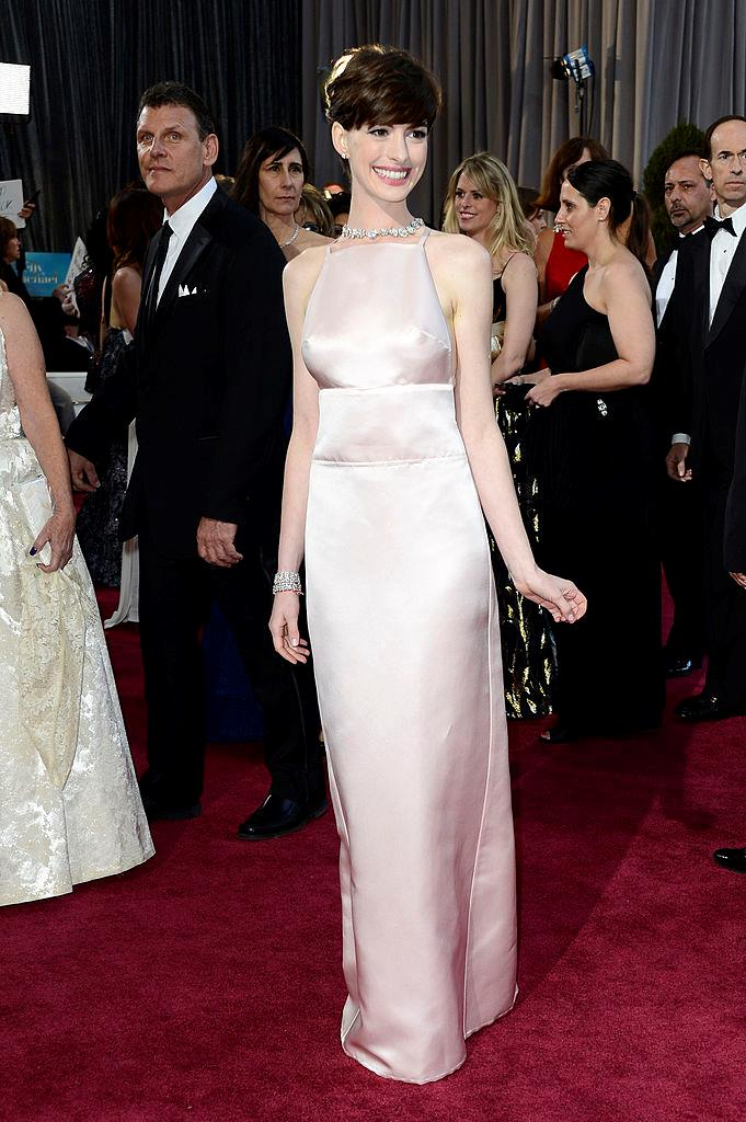 "**Anne Hathaway** <br><br> In 2013, Anne Hathaway won her first Academy Award for *Les Misérables*, and wore this demure pink Prada gown. In 2014, a year after she won the award, Hathaway spoke out about the dress's controversial bust lines, which became a topic of conversation after the ceremony. <br><br> In an interview with [*Harper's BAZAAR* U.S.](https://www.harpersbazaar.com/culture/features/a3888/anne-hathaway-interview-1114/|target=""_blank""