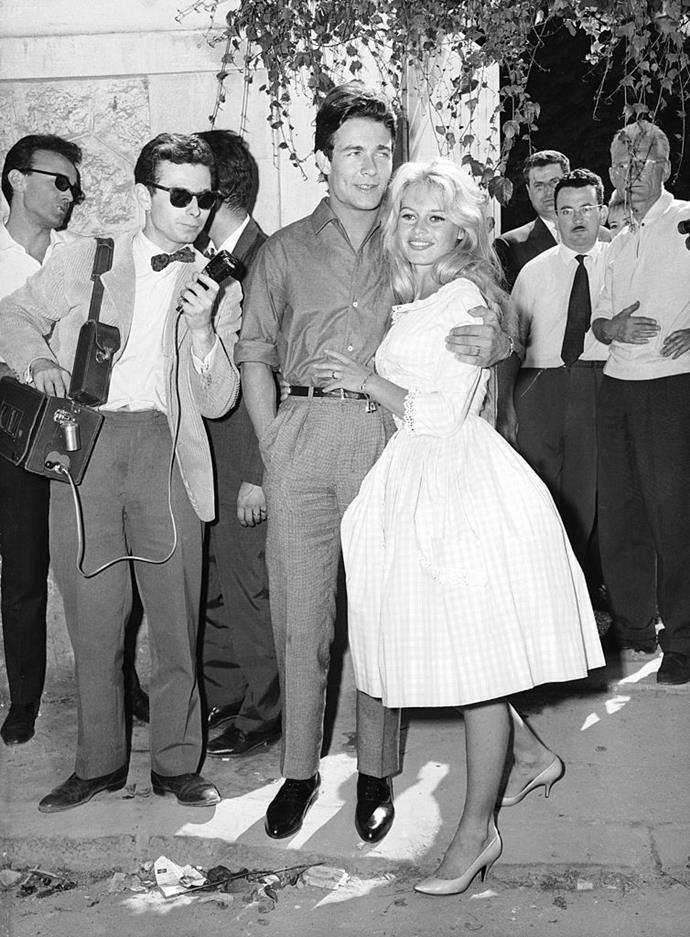 **Brigitte Bardot (1959)** <br><br> For her second marriage to French actor Jacques Charrier, Brigitte Bardot defied convention and wore this short, structured dress, which featured a bateau neckline and faintly-detectable check print.