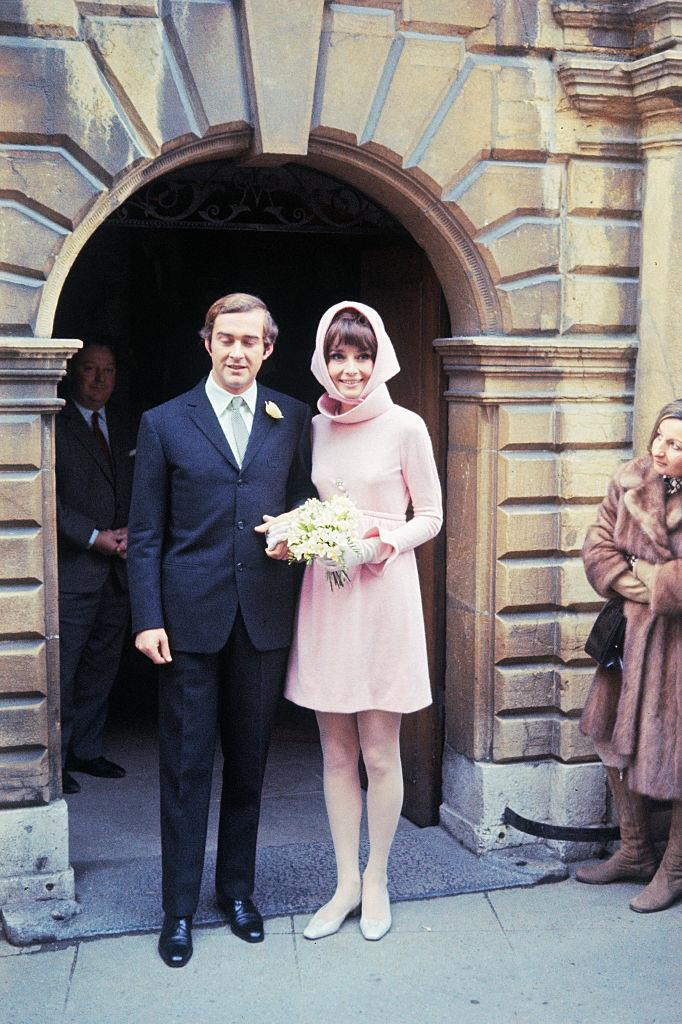 """**Audrey Hepburn (1969)** <br><br> For her second wedding (15 years after she first wed in a conservative Balmain gown), Audrey Hepburn gracefully embodied the spirit of the '60s in this short, soft pink dress designed by her close friend, [Hubert de Givenchy](https://www.harpersbazaar.com.au/fashion/hubert-de-givenchy-audrey-hepburn-15986