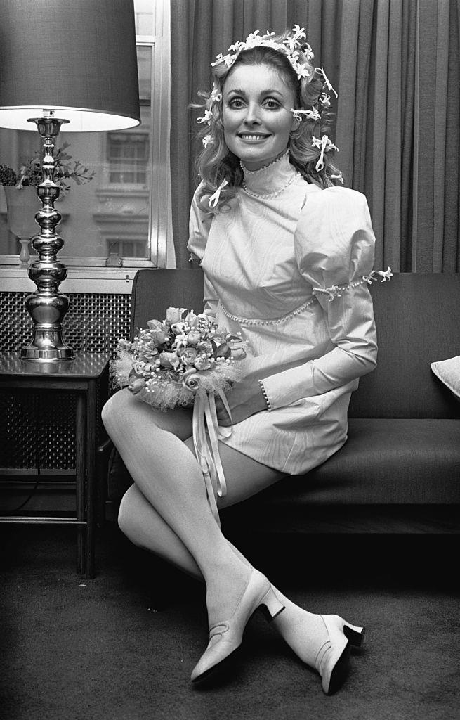 **Sharon Tate (1969)** <br><br> Actress Sharon Tate appeared to channel Elizabeth Taylor with this floral-adorned dress and hairstyle for her 1968 wedding, a year before her untimely death.