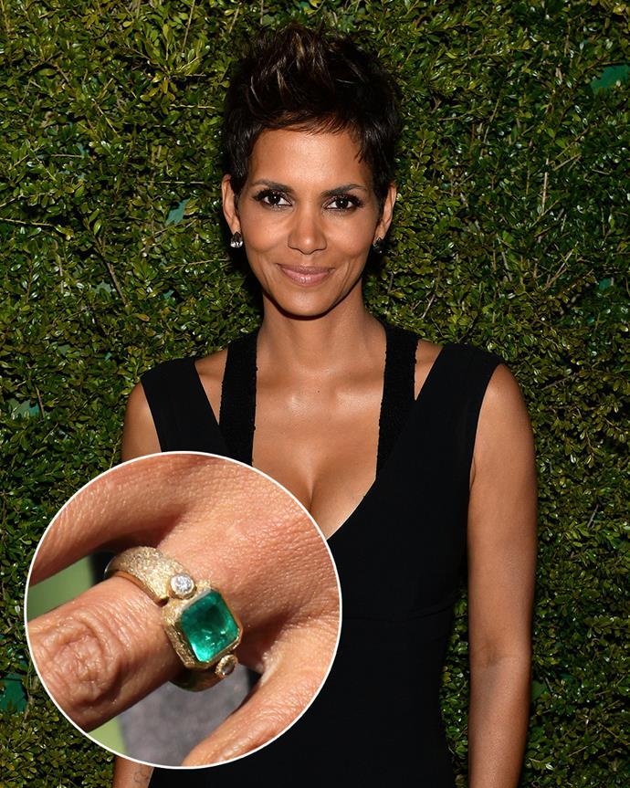 "**The wearer:** Halle Berry<br><br> **The ring:** A 4-carat cushion-cut emerald on a thick gold band.<br><br> **The story:** When Olivier Martinez was planning on proposing to Halle Berry, he tapped his Parisian neighbour and legendary jeweller Robert Mazio to create it. It reportedly has ""esoteric codes"" inscribed into the band which can only be understood by the couple themselves."