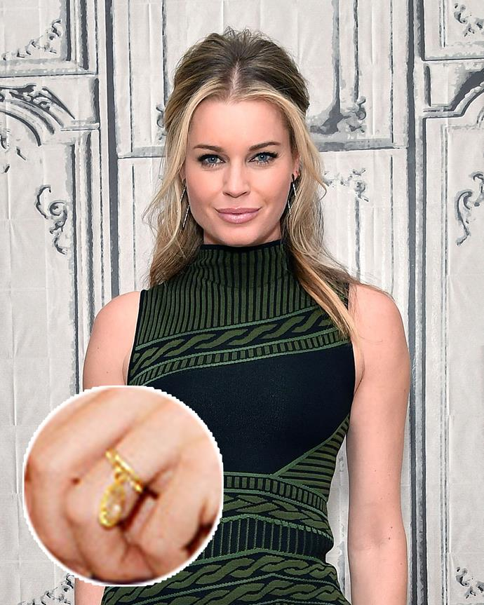 "**The wearer:** Rebecca Romijn<br><br> **The ring:** A 6-carat yellow diamond on a yellow-gold band.<br><br> **The story:** While Rebecca Romijn's Lorraine Schwartz ring may have started out traditional, it was anything but after a redesign in 2008. After having to remove her ring due to swelling fingers during her pregnancy, Romijn had the ring altered so that the diamond dangled off the band. She said of the change, ""There's something sexy about a diamond dangling from your finger."""
