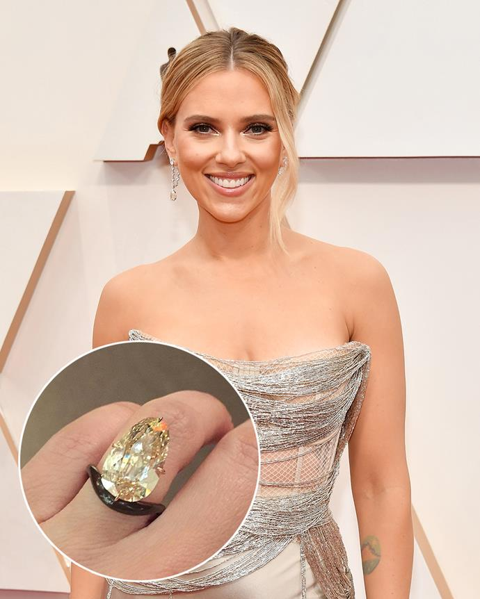 **The wearer:** Scarlett Johansson<br><br> **The ring:** A 11-carat 'light brown' oblong-shaped diamond on a black band.<br><br> **The story:** After receiving two traditional rings from her first two husbands, Ryan Reynolds and Romain Dauriac respectively, Johansson received a very unique rock for her engagement to Colin Jost. The unusual 'light brown' diamond on a black band was designed by James de Givenchy, the nephew of Hubert de Givenchy of the House of Givenchy. Known for innovative and unique designs, de Givenchy often creates one-of-a-kind pieces with unexpected materials. Only Scarlett could pull this one off.
