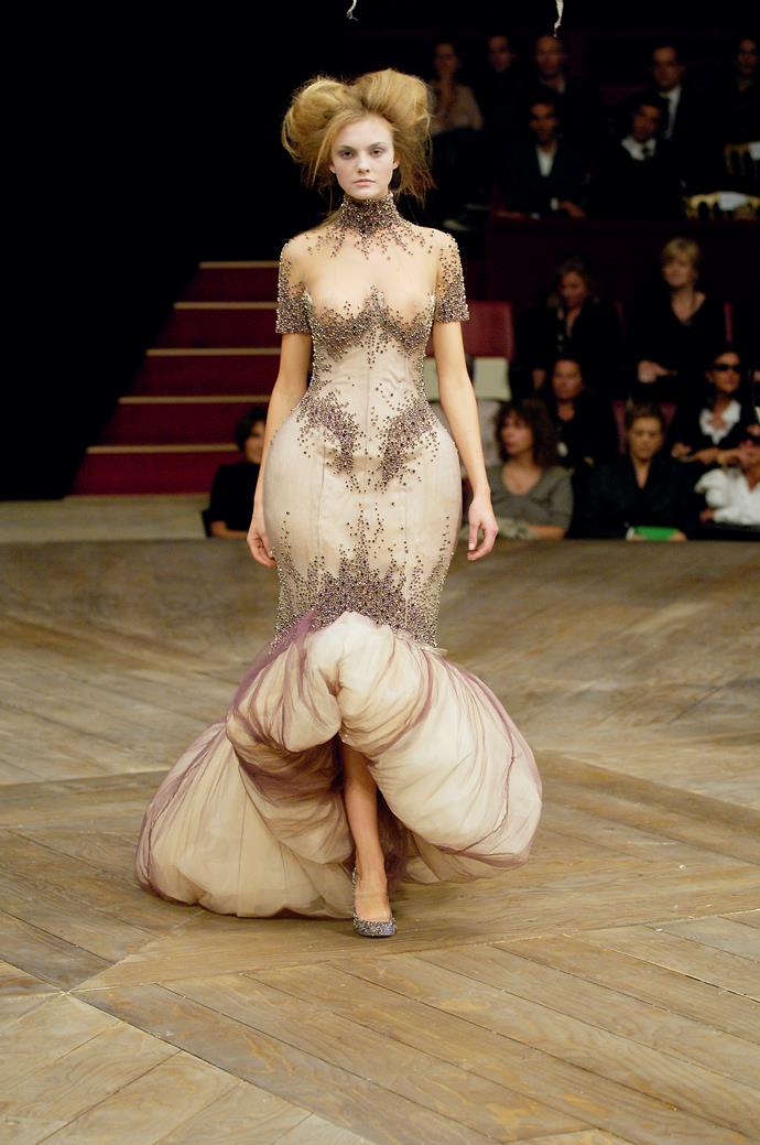 Alexander McQueen's use of Victorian-inspired silhouettes.