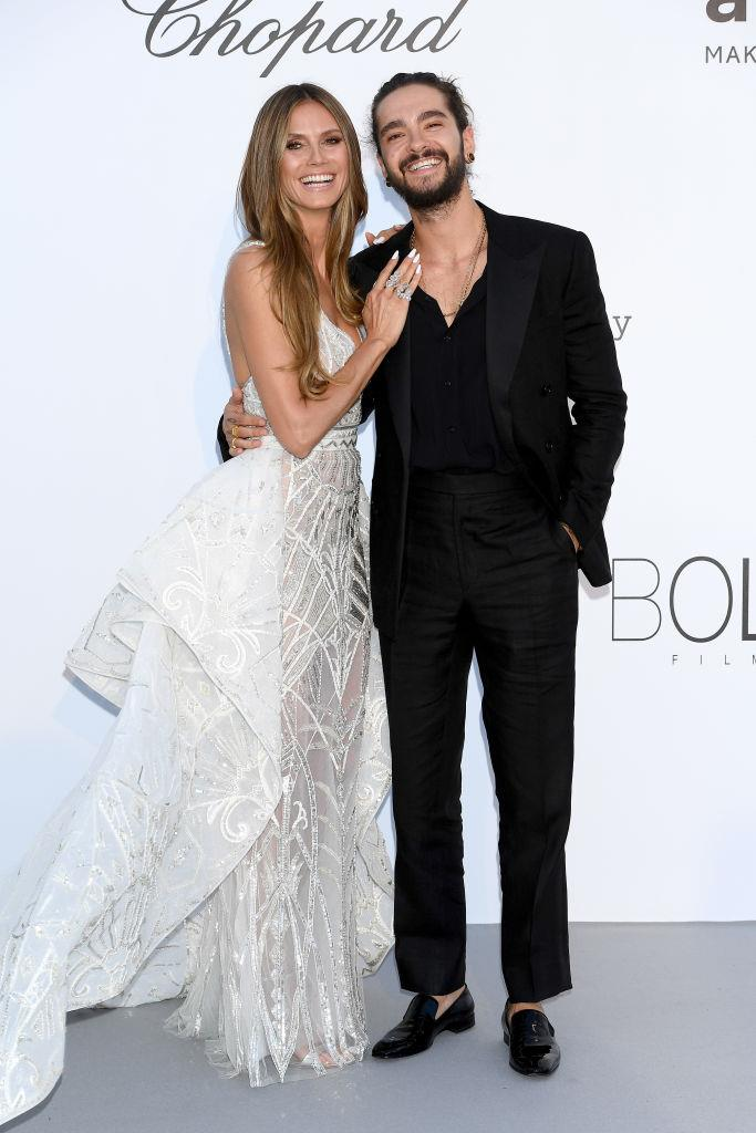 "**Heidi Klum, 46, and Tom Kaulitz, 30**<br><br>  **Age difference:** 16 years<br><br>  Heidi Klum first started dating Tokio Hotel guitarist Tom Kaulitz back in 2018, before tying the knot on a yacht in Italy in August 2019 (in [three wedding dresses](https://www.harpersbazaar.com.au/bazaar-bride/heidi-klum-tom-kaulitz-wedding-19060|target=""_blank""), no less). The German supermodel previously expressed her age has become more of a talking point since she started dating a man many years her junior.<br><br>  ""My boyfriend is many years younger than me, and lots of people are questioning that and asking about it,"" she [said](https://www.instyle.com/news/heidi-klum-downside-dating-someone-17-years-younger