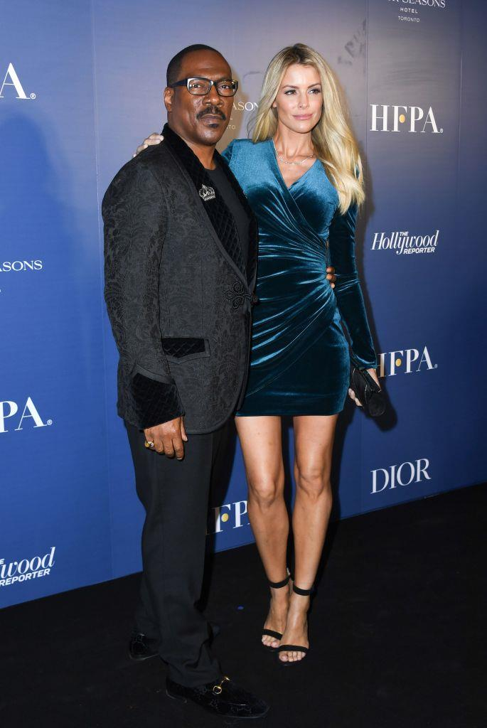 **Eddie Murphy, 59, and Paige Butcher, 40**<br><br>  **Age difference:** 19 years<br><br>  The *Coming to America* star and the Australian model have been together since 2012 and became engaged in 2018. They share two children together, a son named Max and a daughter named Izzy.