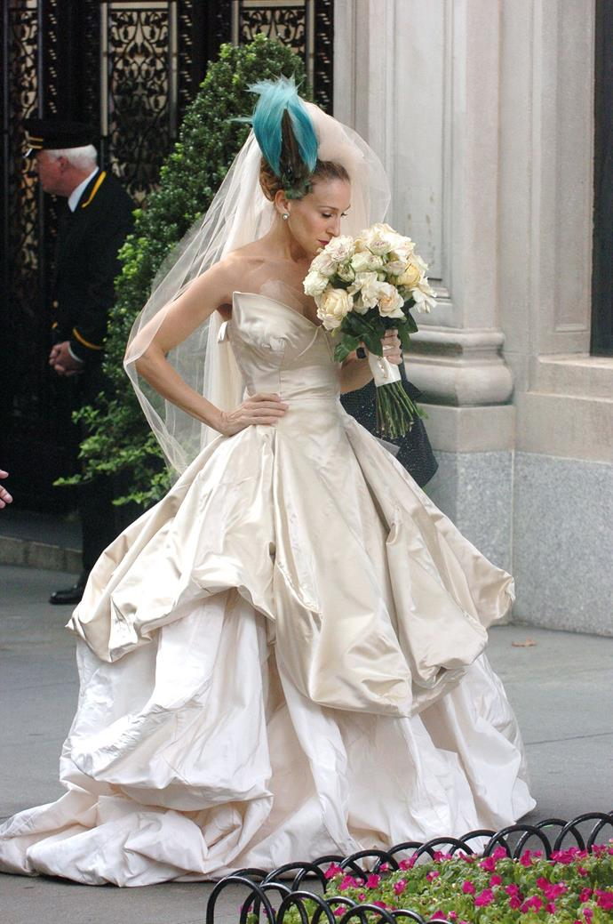 **Carrie Bradshaw's Vivienne Westwood wedding dress in *Sex and the City* (2008)** <br><br> For every fan of Carrie Bradshaw's whimsical Vivienne Westwood wedding dress from her ill-fated marriage to Mr. Big, there was a sea of detractors, who thought the look could've been more classic. However, it's Carrie Bradshaw we're talking about here, and those who know and love her fashion sense know some of her best looks are a little kooky. <br><br> With its signature exaggerated Westwood tailoring, this dress undoubtedly remains iconic in our eyes.