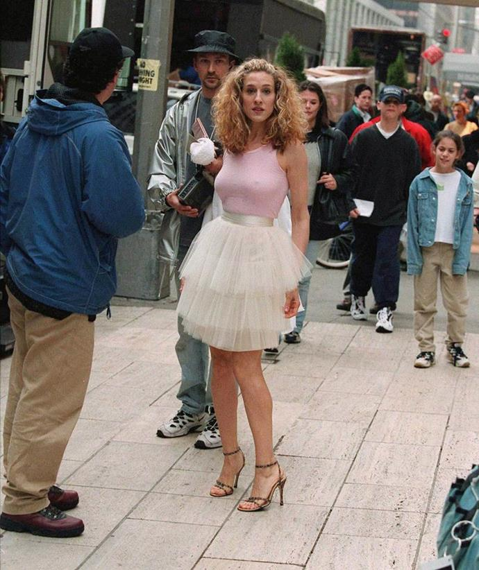 **Carrie Bradshaw's tutu in *Sex and the City* (1998)** <br><br> The real-life controversy surrounding Carrie Bradshaw's iconic tulle tutu only serves to add to its appeal. <br><br> Before *Sex and the City* had even aired, costume designer Patricia Field purchased the dress for $5 from a bargain bin, and had to convince Darren Star, the show's creator, that it would be right for Carrie (even though Sarah Jessica Parker was immediately on board with the idea). Though the look became one of the most iconic in TV history, could you imagine if it never was?