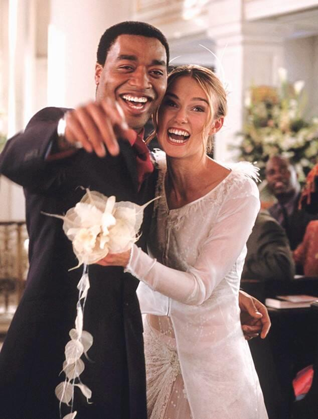 """**The *Love, Actually* wedding dress (2003)** <br><br> Juliet's character arc in *Love, Actually* was controversial enough, but her wedding day look is firmly imprinted in our brains. Be it the feathers on the halo and shoulders, the unexpected sheer design, or the curly tendrils, this look is about as quintessentially [2000s](https://www.harpersbazaar.com.au/fashion/celebrities-partying-90s-2000s-17922