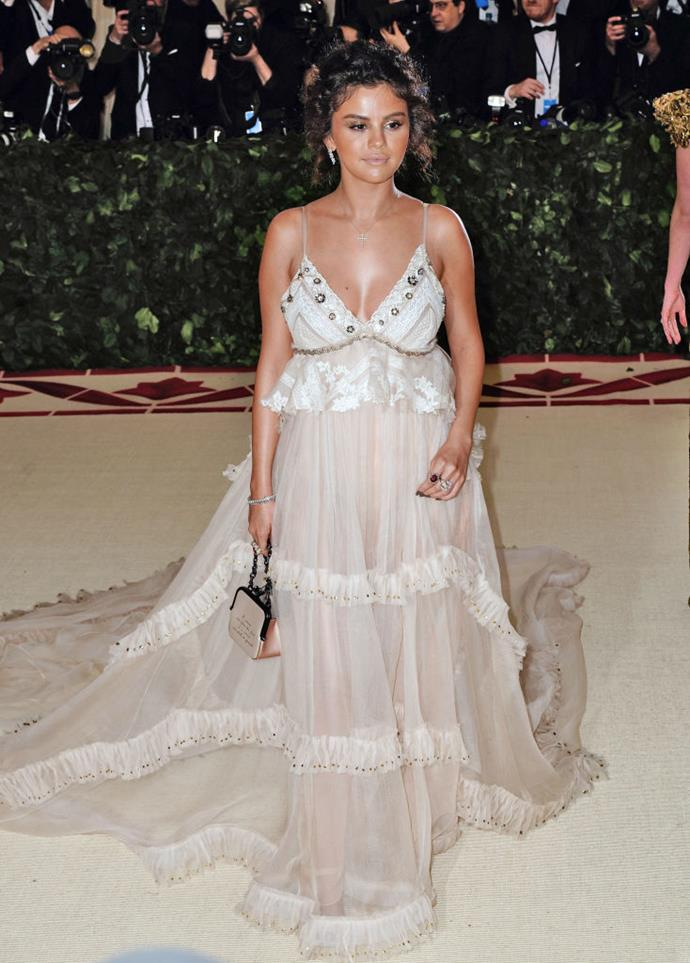 "**Selena Gomez** <br><br> Gomez wore a Coach by Stuart Vevers to the 2018 Met Gala, which she said was inspired by the biblical figure Queen Esther. While the dress was stunning, Gomez later hinted at being unhappy with how the look turned out in pictures, which had to do with her dark spray tan and face makeup. <br><br> Following the ball, the singer and actress shared an [Instagram](https://www.instagram.com/p/Bij9CgvgbUY/|target=""_blank""
