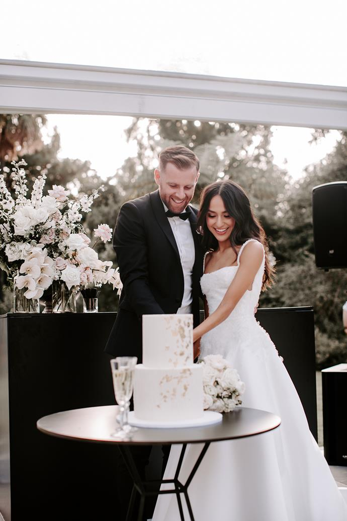 **On picking a cake:** We only decided four weeks out from the wedding we were going to have a cake and were so lucky that our wedding planners were able to work their magic. The cake was a textured two-tier white chocolate cake with buttercream and delicate gold leaf detailing.