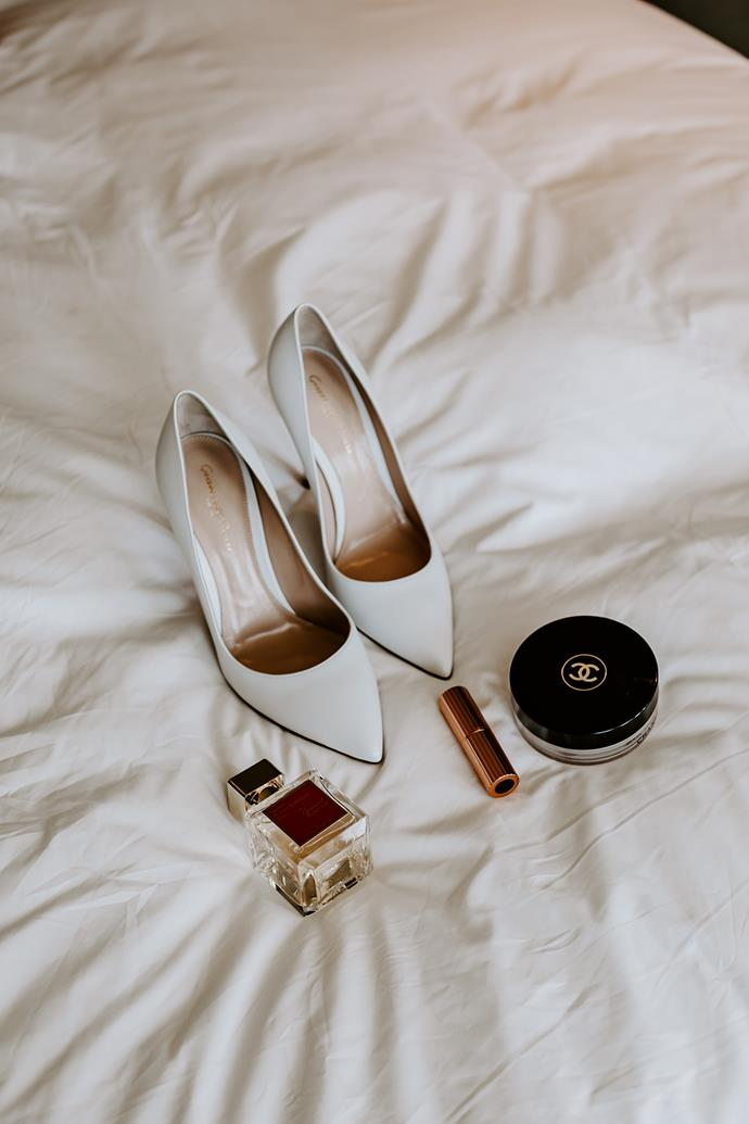 **On her accessories:** I am very simplistic every day and wanted to stay true to myself, also having such a big dress and veil, I didn't feel like accessories were necessary. I kept it minimal with classic white pumps, diamond studs and my engagement ring of course.