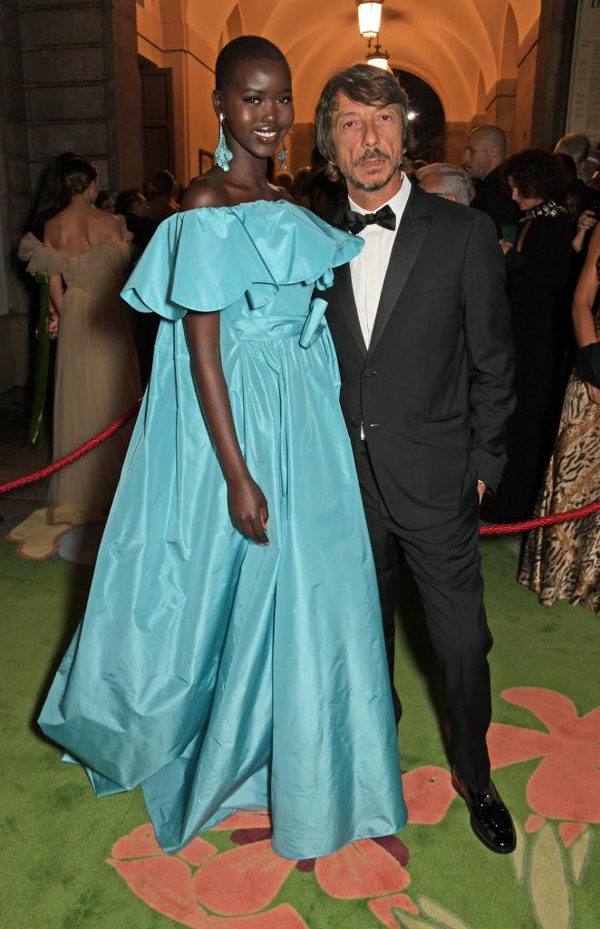 """**Pierpaolo Piccioli and Adut Akech** <br><br> Piccioli's work as creative director of Valentino is highly acclaimed by fashion critics, and supermodel-in-the-making Adut Akech could be considered his main muse. Akech is a former refugee who escaped war-torn South Sudan during her childhood, and eventually settled in Australia before becoming a model. <br><br> In a 2019 interview with *[Business of Fashion](https://sg.style.yahoo.com/adut-akech-pierpaolo-piccioli-makes-feel-accepted-010000157.html