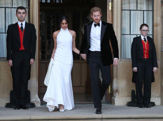 Duchess Meghan Markle (in Stella McCartney) with Prince Harry, en route to their wedding reception in May 2018.