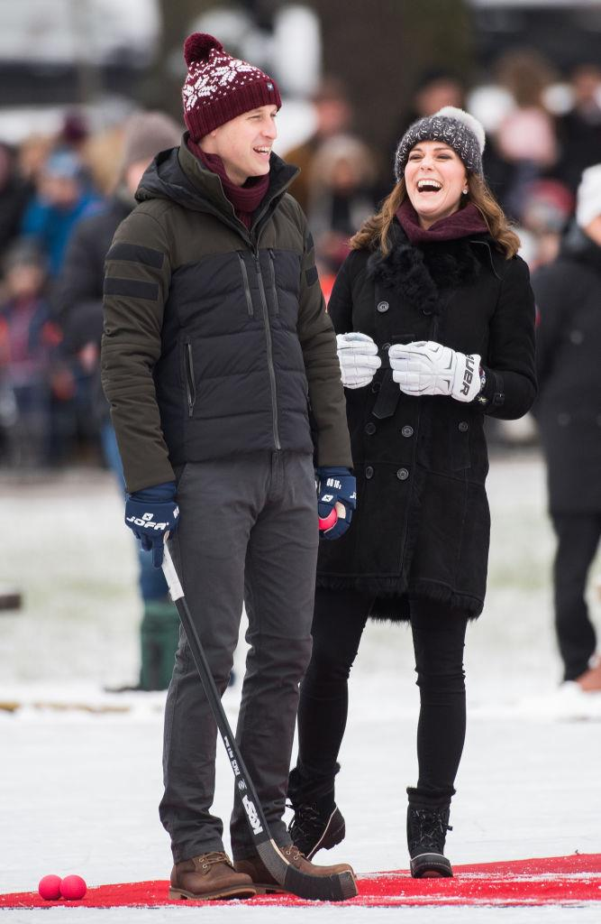 Prince William and Kate Middleton wearing matching beanies in 2018.