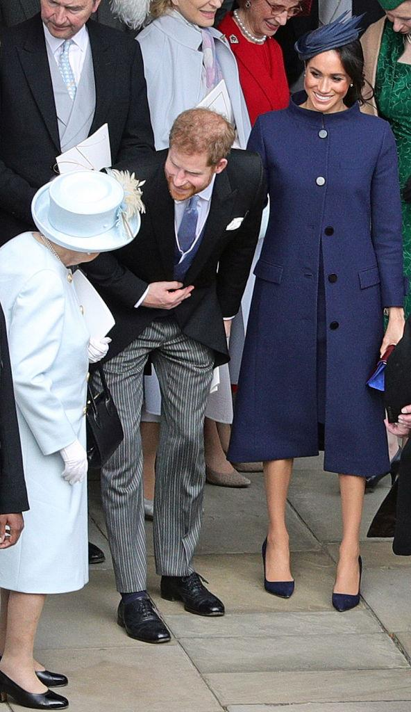 Prince Harry and Meghan Markle (in Givenchy) at the wedding of Princess Eugenie and Jack Brooksbank in October 2018.