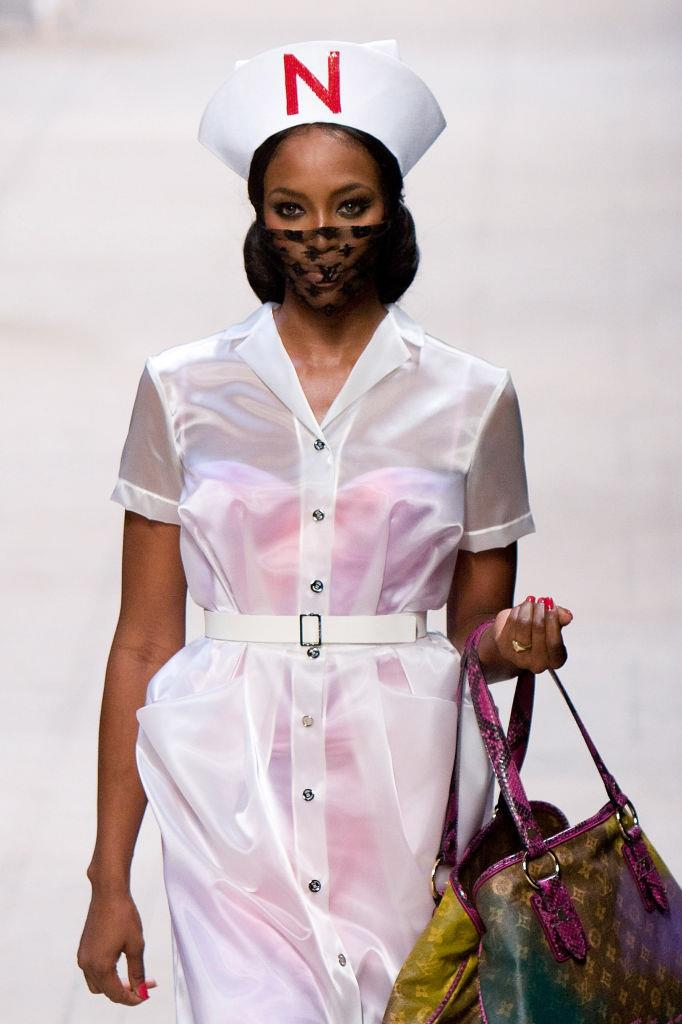 """On the runway at Louis Vuitton's spring/summer '08 show, under ex-creative director Marc Jacobs. The show's iconic masks, embroidered with the LV monogram print, have since become an [unexpected symbol of the coronavirus pandemic](https://www.harpersbazaar.com.au/fashion/louis-vuitton-spring-2008-coronavirus-20131