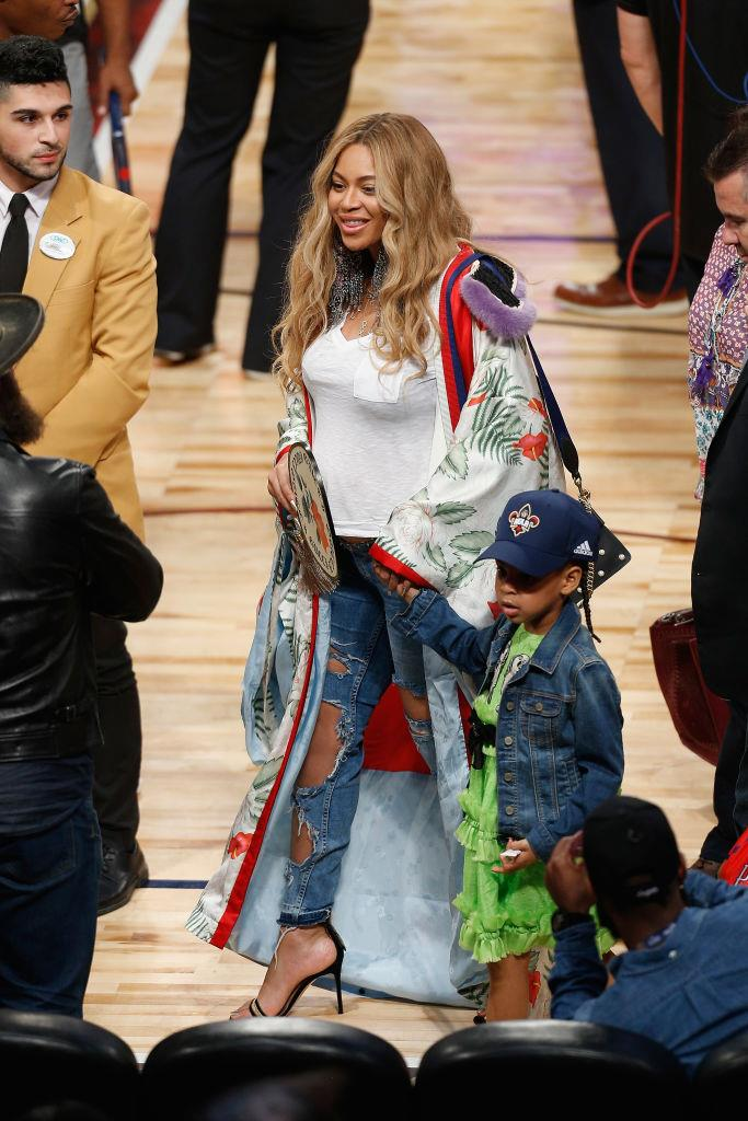 Beyoncé in a $15,000 Gucci coat at a basketball game in 2017.