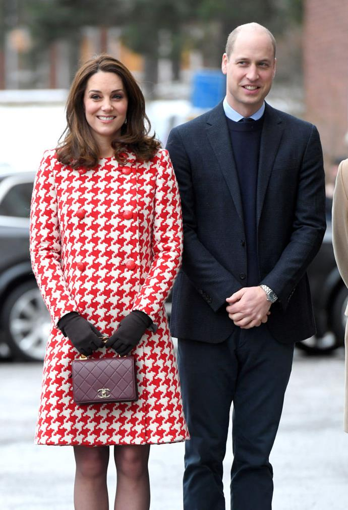 Duchess Kate Middleton in a Catherine Walker coat, and carrying a Chanel handbag, in 2018.