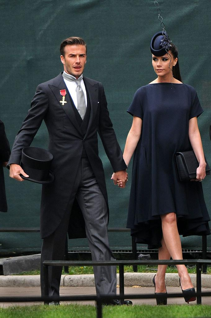 Victoria Beckham in her own label, with a Phillip Treacy fascinator and platform Christian Louboutin pumps, at the wedding of Prince William and Duchess Kate Middleton in 2011.