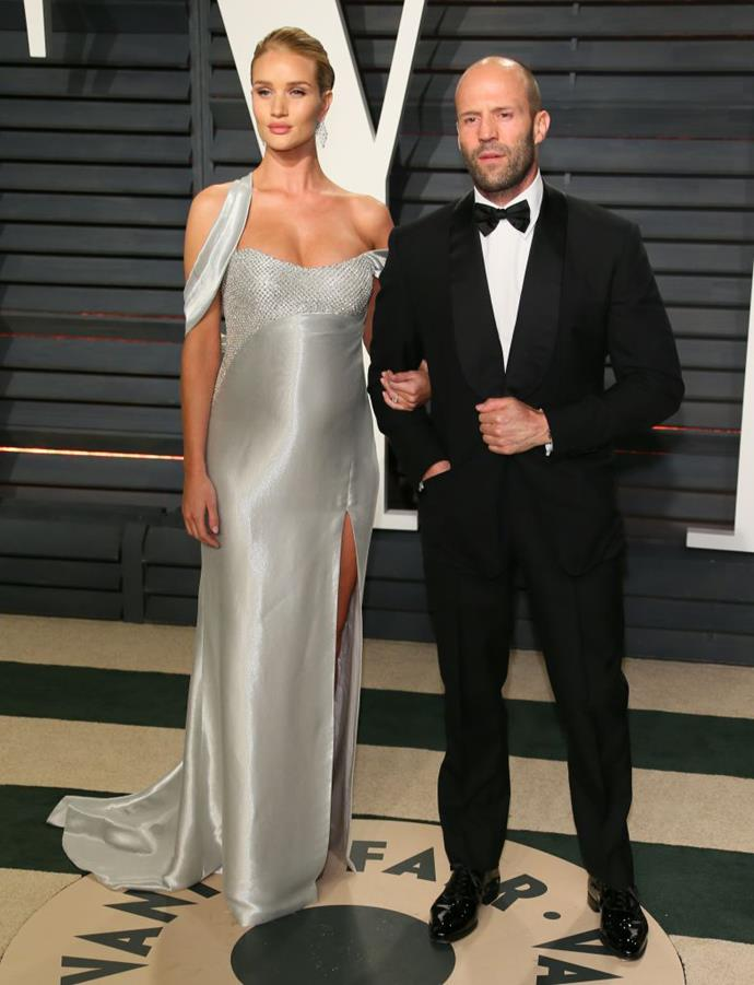 Rosie Huntington-Whiteley in Versace at the 2017 *Vanity Fair* Oscars Party with her longtime partner, Jason Statham.