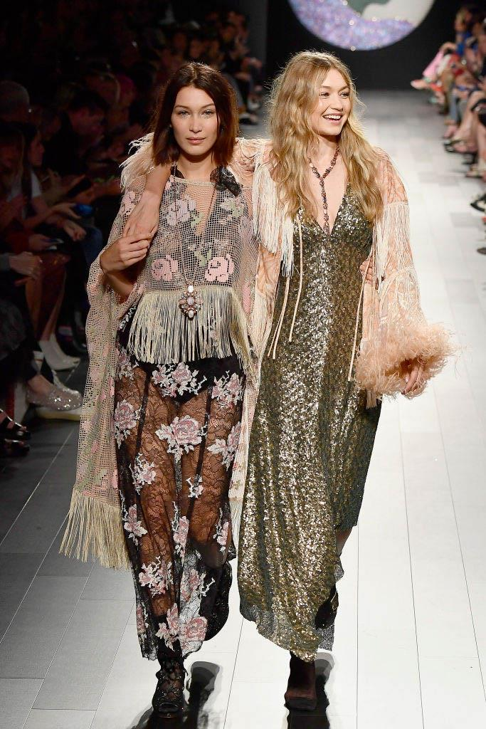 **Gigi Hadid at Anna Sui spring/summer '18** <br><br> Though she didn't actually fall, Gigi Hadid narrowly avoided a runway trip when her shoe came off at Anna Sui's spring/summer '18 show. Thankfully, Bella Hadid (who was also walking the show) came to the rescue, and finished the runway with her older sister to help her balance.