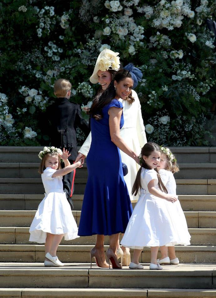 Duchess Kate and Princess Charlotte with Jessica Mulroney, a close friend of Meghan Markle's, and two other young bridesmaids on Meghan and Harry's 2018 wedding day.