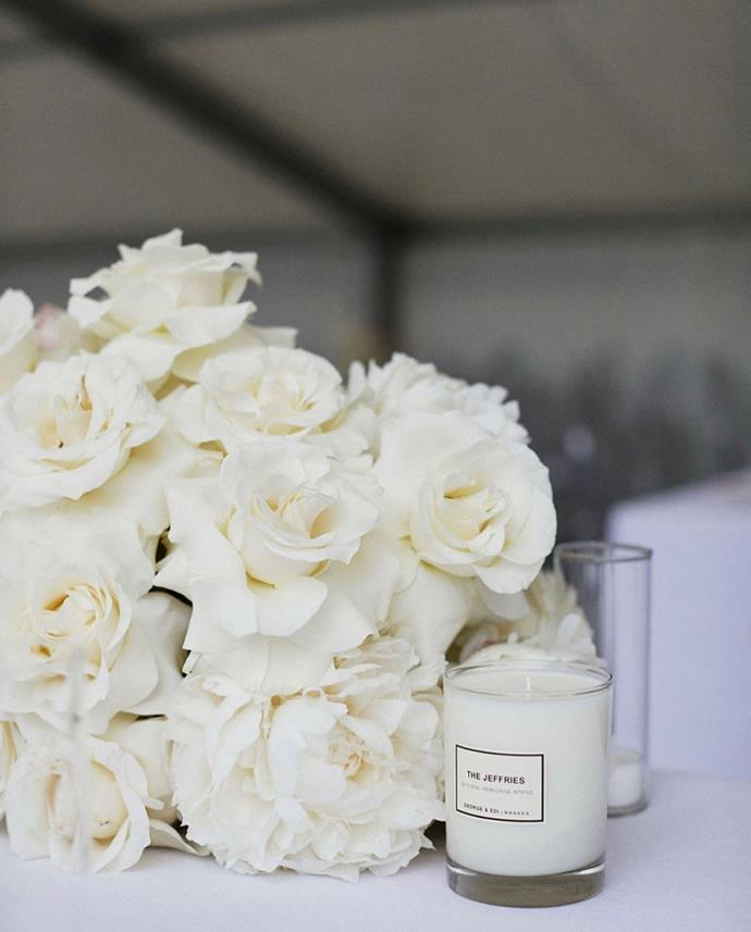 """**On favours:** Each guest received a custom fragrance George and Edi candle with """"THE JEFFRIES"""" and our wedding date on the front individually wrapped in floral paper. It was the same scent that burnt all night long, and I hoped to leave the guests with a lasting memory of our day."""