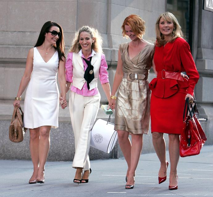"""***Sex and the City***<br><br>  From Carrie's $5 tutu in the opening credits, to making Manolo Blahnik a household name, *Sex and the City* easily counts as one of the chicest shows to have ever graced our TVs. Beyond [Carrie Bradshaw's many iconic outfits](https://www.harpersbazaar.com.au/fashion/carrie-bradshaw-outfits-17857 target=""""_blank""""), each of the characters had their own sense of style ([Miranda's was underrated](https://www.elle.com.au/fashion/miranda-style-sex-and-the-city-20008 target=""""_blank"""")), giving the show plenty of variety as far as fashion was concerned.<br><br>"""