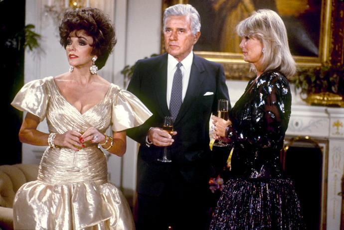 ***Dynasty***<br><br>  *Dynasty* gave us the '80s 'old money' in all its audacious glory and the clothes to go with it. Think: behemoth shoulder pads, feather boas and big hair with bigger (almost) diamonds. Glorious.