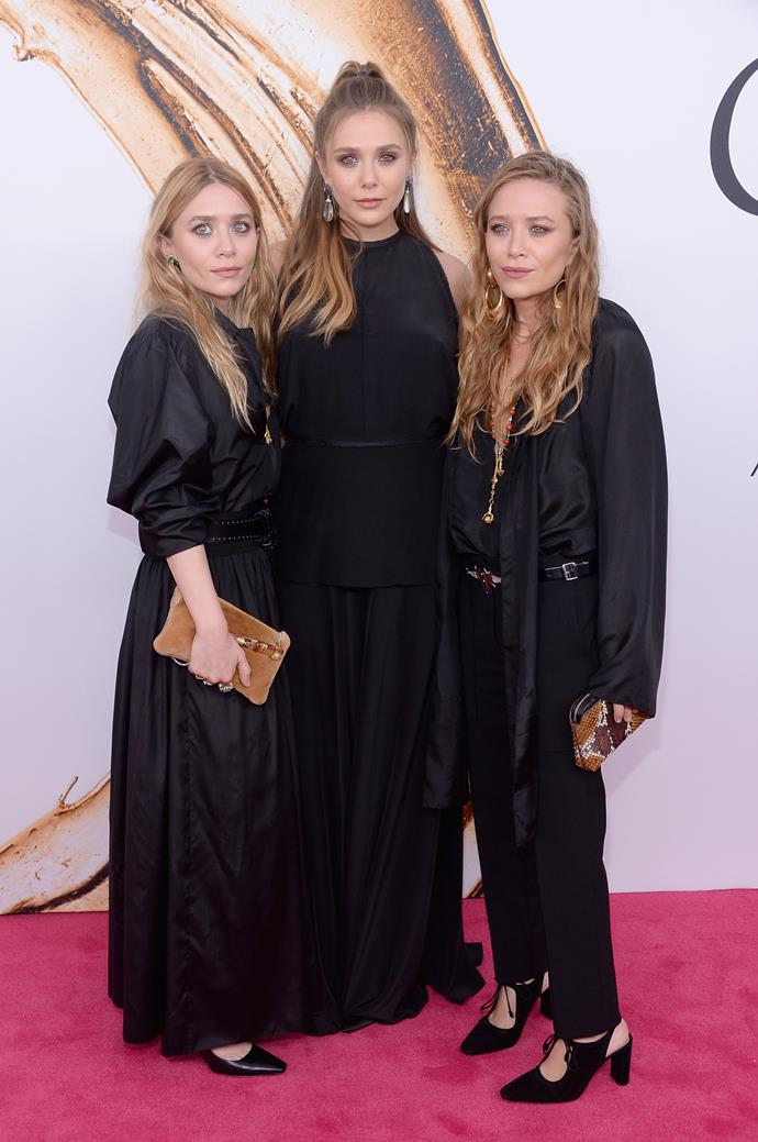 """**Mary-Kate and Ashley Olsen** (far left and far right) are 152cm, or 5""""0', tall."""