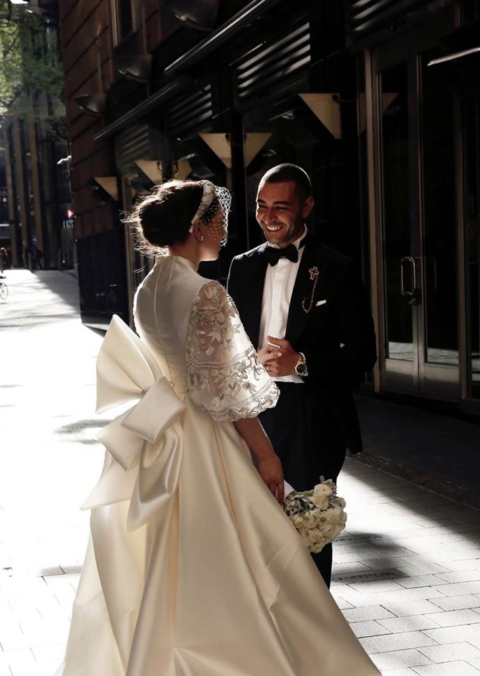 "Ilana in Steven Khalil. See more [here](https://www.harpersbazaar.com.au/bazaar-bride/steven-khalil-wedding-dress-19663|target=""_blank"")."