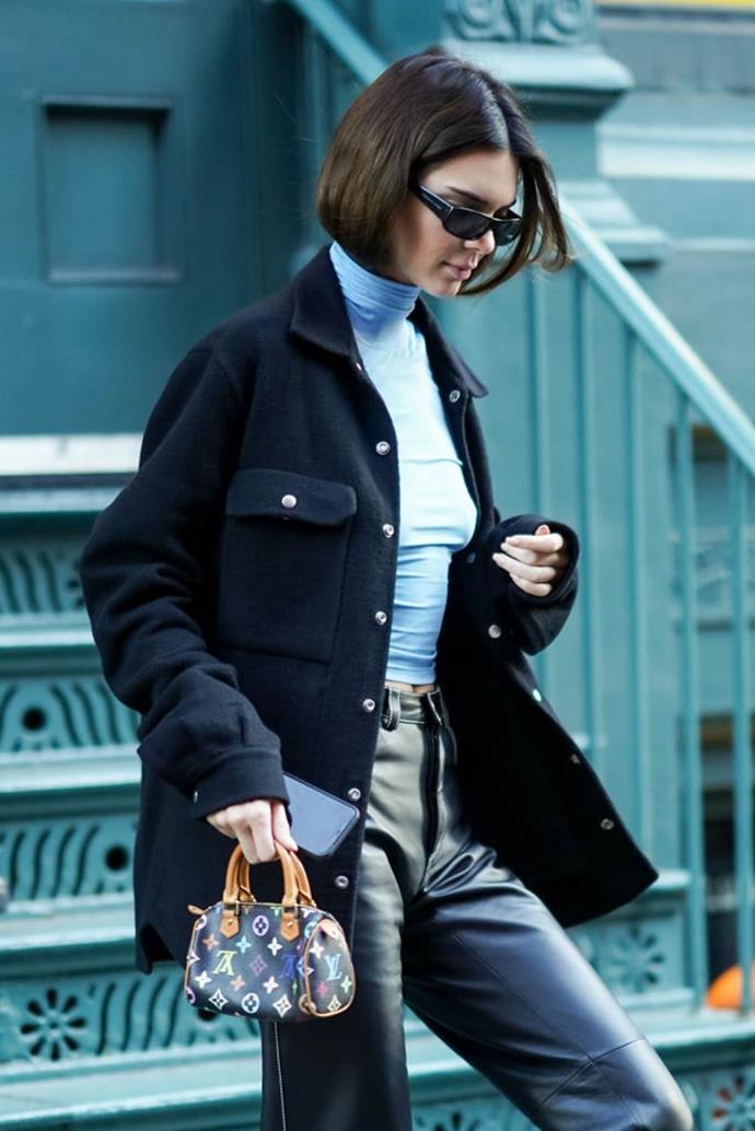 Jenner carrying a vintage multi-colour Louis Vuitton handbag in December 2019.