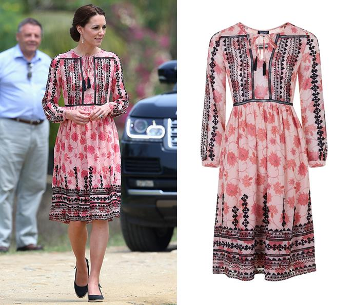While in India, Kate stepped out in a pink and black Topshop dress.