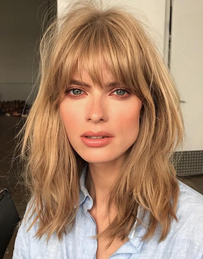 """**THE LOB WITH CURTAIN BANGS**<br><br>  **Ali Holmes, Co-Owner of [Wildlife Sogo Salon](http://www.wildlifehair.com/