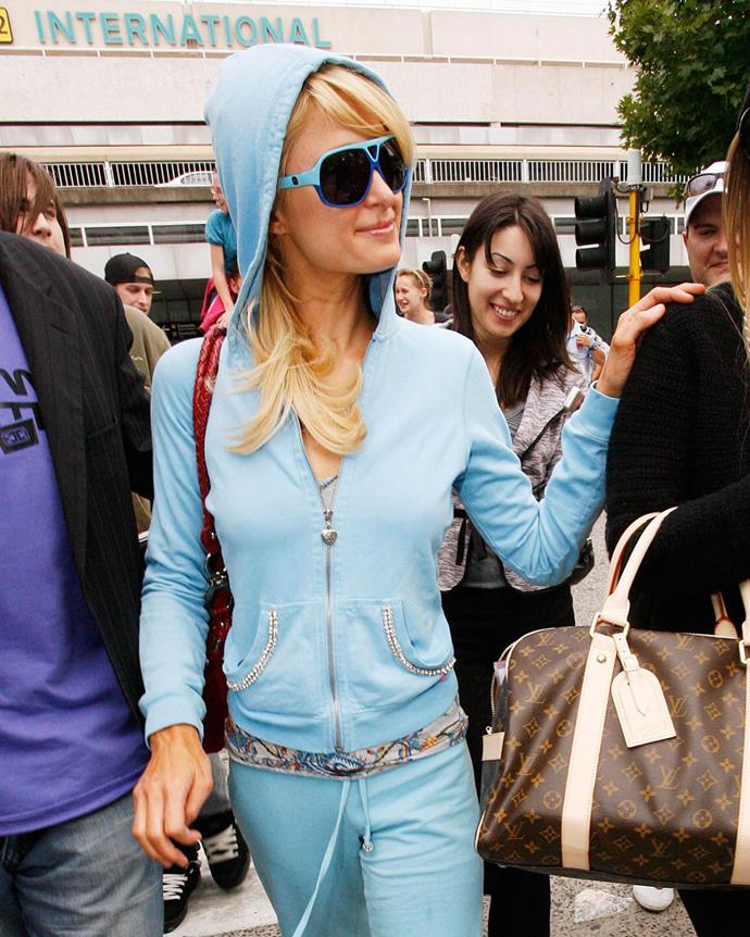 ***2003: Juicy Couture's velour hoodie***<br><br> Pictured: Paris Hilton wearing a Juicy Couture velour tracksuit in 2008.
