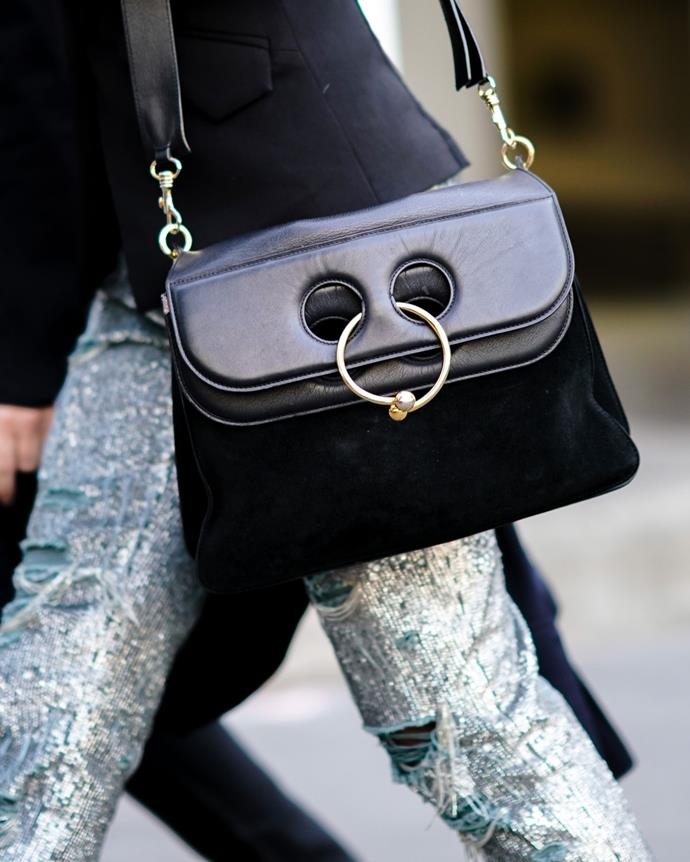 ***2016: JW Anderson's Pierce bag***<br><br> Pictured: A guest wearing the Pierce bag at fashion week in 2018.