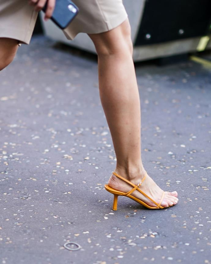 ***2019: The Row's Bare sandals***<br><br> Pictured: A guest wearing the sandals to London Fashion Week in 2019.