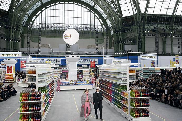 **Chanel autumn/winter '14** <br><br> Lagerfeld transformed the Grand Palais (the enormous auditorium where Chanel holds the majority of their fashion shows) into a luxe supermarket for autumn/winter '14, where we're sure that no toilet-paper hoarding takes place.