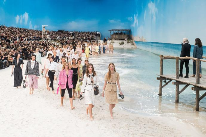 **Chanel spring/summer '19** <br><br> As spring/summer '19 was the final Chanel show attended by Karl Lagerfeld before his passing, the collection holds sentimental value for many. However, we can't overlook the striking beach set, with incredibly convincing faux-waves lapping up on the (real) sand. It's hard to believe this was struck up in the middle of Paris!