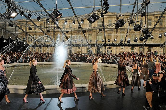 """**Louis Vuitton autumn/winter '11** <br><br> How do you take a fashion show at the Louvre to the next level? You hold the show outside the museum and centre it around a fountain, of course. In a makeshift auditorium at the Cour Carrée du Louvre, creative director [Marc Jacobs](https://www.harpersbazaar.com.au/fashion/marc-jacobs-autumn-winter-2020-19929
