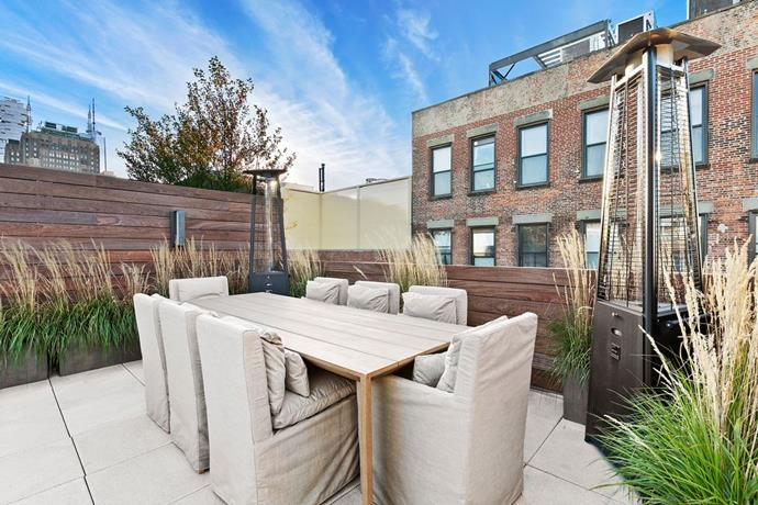 The private outdoor terrace, also includes a 12-seat dining table for entertaining. <br> *Corcoran*