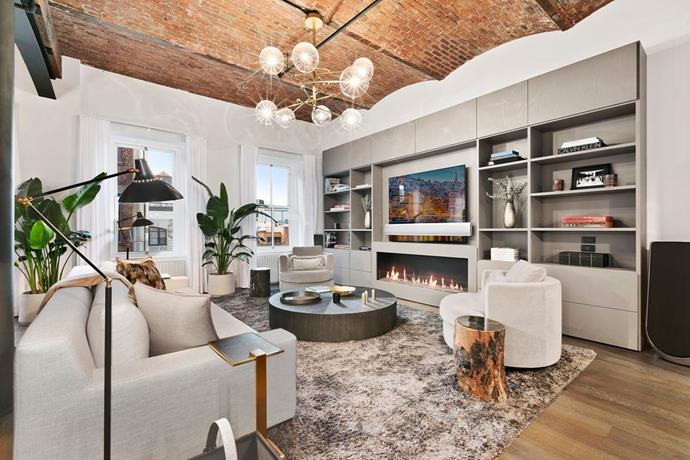 The living room, featuring exposed brick ceiling. <br> *Corcoran*