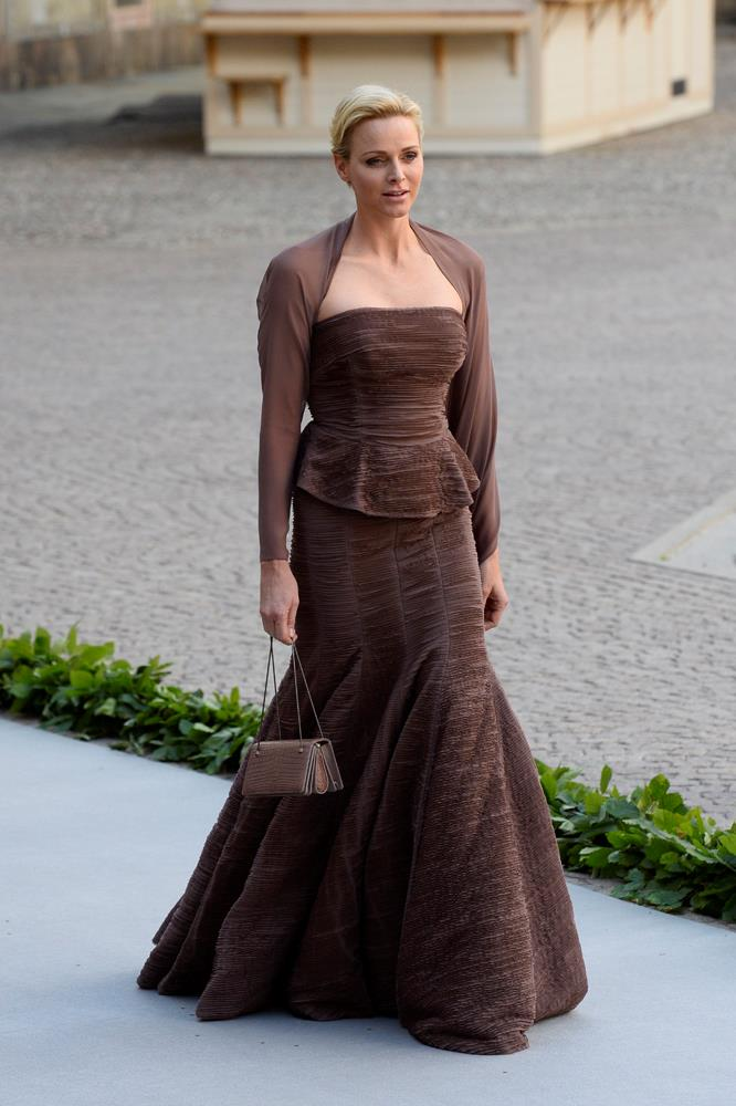 Princess Charlene of Monaco attending the wedding of Princess Madeleine of Sweden and Christopher O'Neill in 2013.