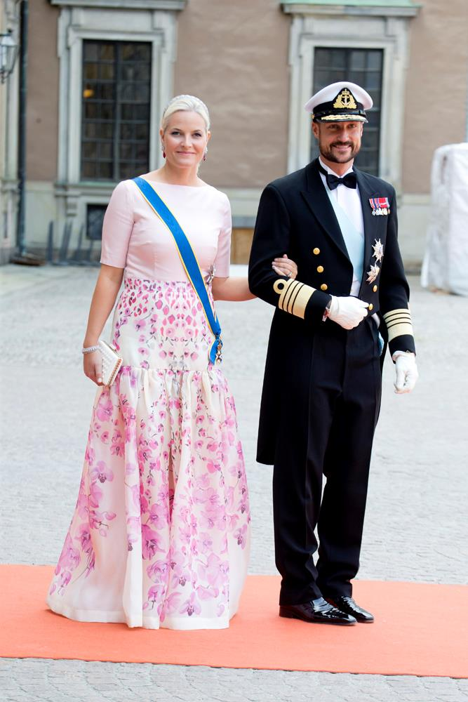 Princess Mette-Marit of Norway (and Prince Haakon of Norway), in Temperley London, attending the wedding of Prince Carl Philip of Sweden and Sofia Hellqvist in 2015.