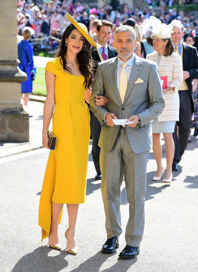 Amal Clooney, in Stella McCartney, (and George Clooney) attending the wedding of Prince Harry and Meghan Markle in 2018.